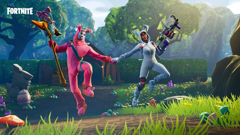 Fortnite characters jump, holding hands, dressed in bunny costumes.