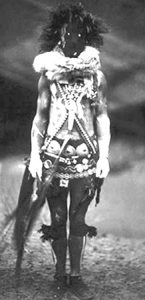 A Navajo person dressed in costume to resemble a skinwalker, or Navajo witch