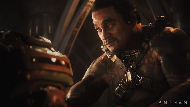 "Screenshot of ""Anthem,"" featuring one of the NPC team members that will support the player character. Image depicts a heavily tattooed man."