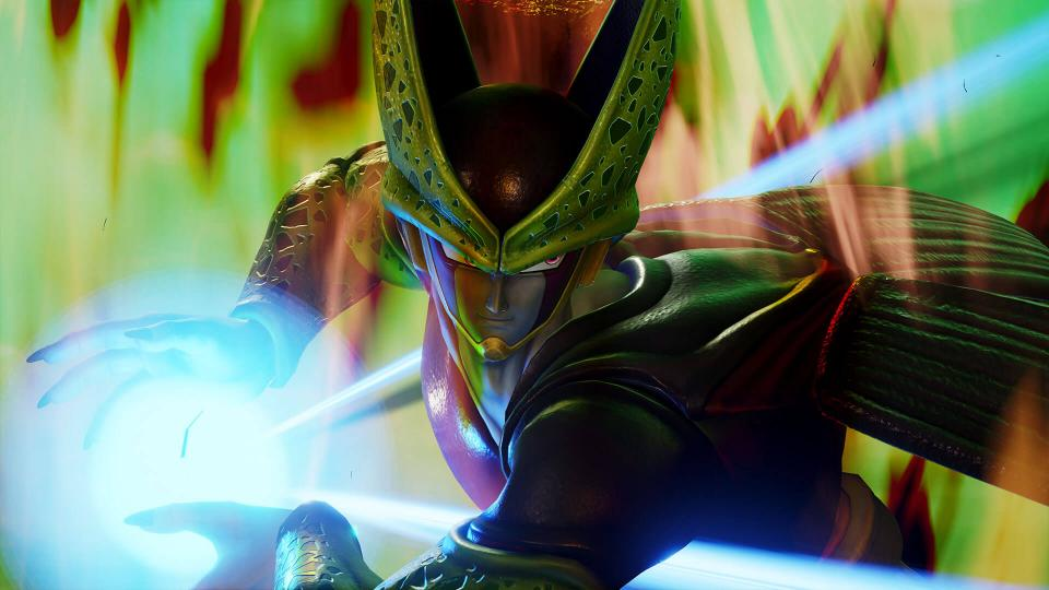 """Jump Force"" screenshot of Cell, a green chimera-like and insectoid character, charging a powerful energy blast with his hands."